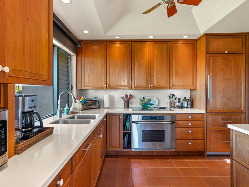 Custom design, teak cabinets in remodeled kitchen